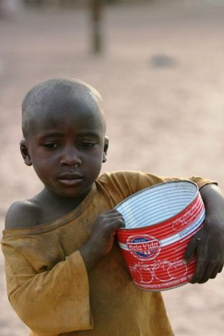 3_A_young_Talibe_begs_for_money_and_food_